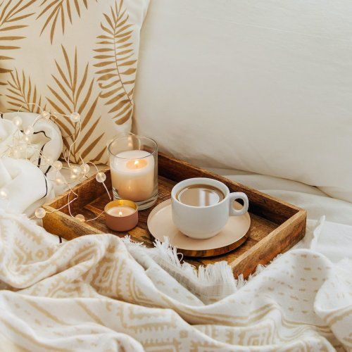 Coffee and candles in a wood tray